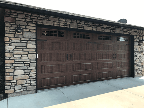 new garage door installed wood pattern